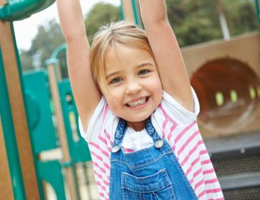Young Girl On Climbing Frame