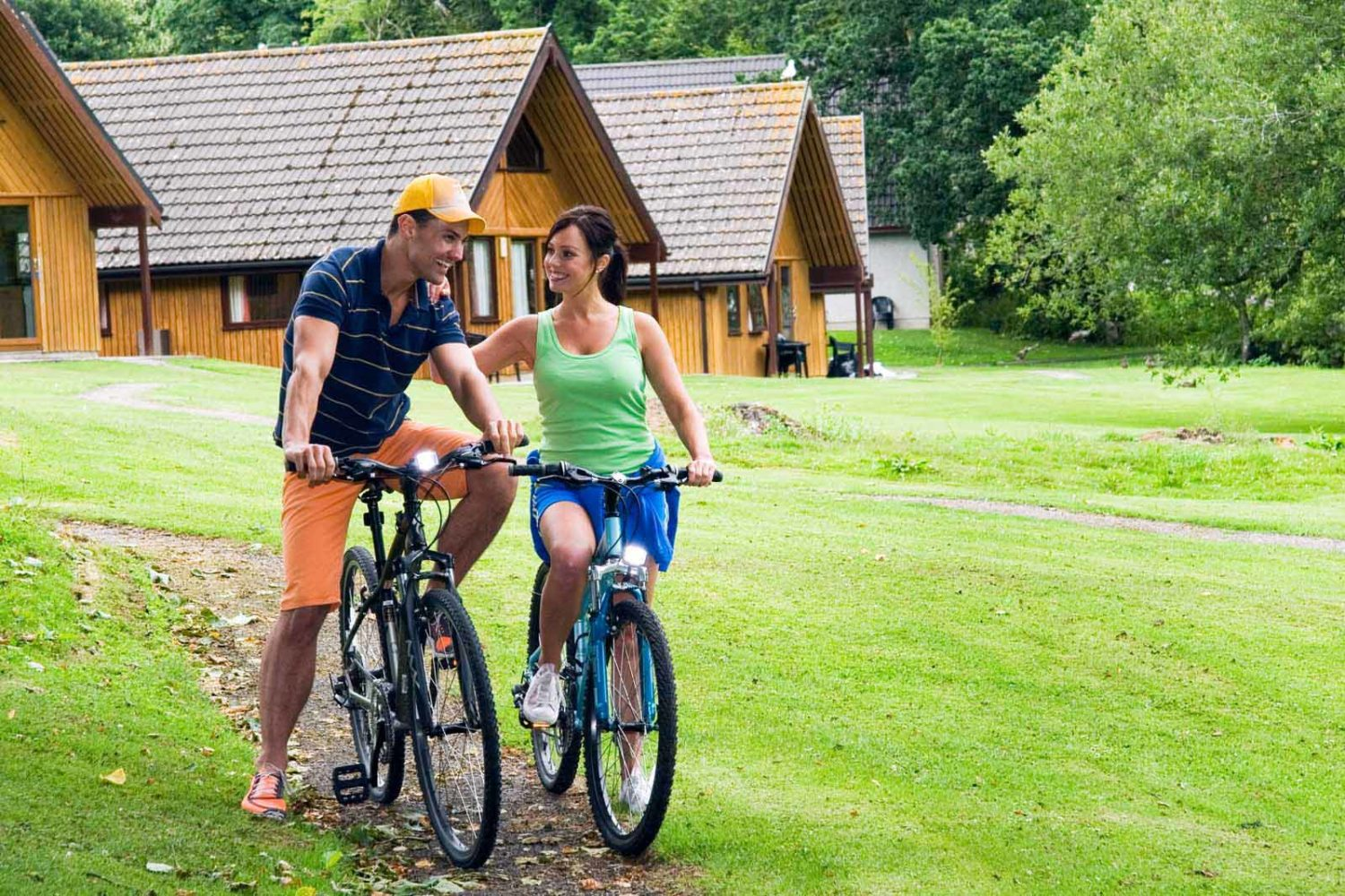 couple cycling lodges