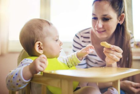 baby eating with mum